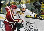10 February 2012: Boston College Eagles defenseman Patch Alber, a Junior from Clifton Park, NY, battles UVM forward Tobias Nilsson-Roos, a Junior from Malmo, Sweden, during action against the University of Vermont Catamounts at Gutterson Fieldhouse in Burlington, Vermont. The Eagles defeated the Catamounts 6-1 in their Hockey East matchup. Mandatory Credit: Ed Wolfstein Photo