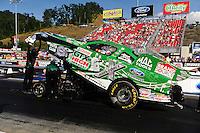 Jun. 15, 2012; Bristol, TN, USA: NHRA crew members for funny car driver John Force during qualifying for the Thunder Valley Nationals at Bristol Dragway. Mandatory Credit: Mark J. Rebilas-