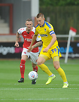 AFC Wimbledon's Joe Pigott under pressure from Fleetwood Town's Peter Clarke<br /> <br /> Photographer Kevin Barnes/CameraSport<br /> <br /> The EFL Sky Bet Championship - Fleetwood Town v AFC Wimbledon - Saturday 10th August 2019 - Highbury Stadium - Fleetwood<br /> <br /> World Copyright © 2019 CameraSport. All rights reserved. 43 Linden Ave. Countesthorpe. Leicester. England. LE8 5PG - Tel: +44 (0) 116 277 4147 - admin@camerasport.com - www.camerasport.com