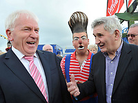 25-8-2011: Former Kerry footballer Minister Jimmy Deenihan has a laugh with his great mentor Mick O'Dwyer as they watch The parade of Charlie Chaplin Lookalikes on Waterville Main Street in County Kerry at the opening of the Charlie Chaplin Film Festival on Thursday. The comedy film festival continues until Sunday which also features The tramps Ball, Circus Skills workshops and a cultural and sports programme.<br /> Picture by Don MacMonagle