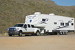 Ford Super Duty towing fifth wheel trailer.