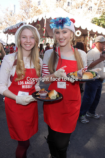 LOS ANGELES, CA - December 24: Elise Luthman, Tara-Nicole Azarian at The Los Angeles Mission Christmas Eve Celebration, Los Angeles Mission, Los Angeles, December 24, 2013. .<br />