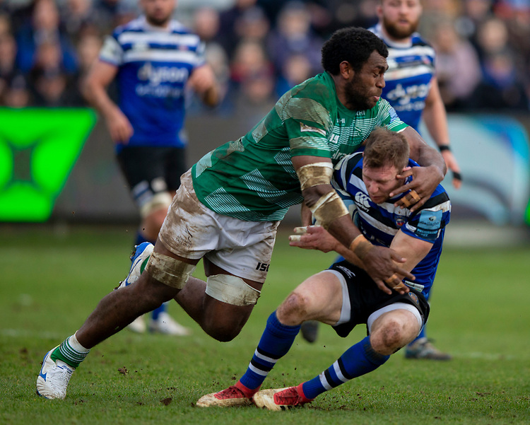 Bath's Will Chudley is tackled by Newcastle's Nemani Nagusa<br /> <br /> Photographer Bob Bradford/CameraSport<br /> <br /> Gallagher Premiership - Bath Rugby v Newcastle Falcons - Saturday 16th February 2019 - The Recreation Ground - Bath<br /> <br /> World Copyright © 2019 CameraSport. All rights reserved. 43 Linden Ave. Countesthorpe. Leicester. England. LE8 5PG - Tel: +44 (0) 116 277 4147 - admin@camerasport.com - www.camerasport.com