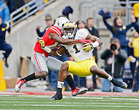 Michigan Wolverines wide receiver Devin Funchess (1) makes a catch gainst Ohio State Buckeyes cornerback Doran Grant (12) in the 1st quarter of their game at Ohio Stadium in Columbus, Ohio on November 29, 2014.  (Dispatch photo by Kyle Robertson)