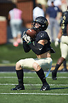 Alex Bachman (1) of the Wake Forest Demon Deacons warms-up prior to the game against the Notre Dame Fighting Irish at BB&T Field on September 22, 2018 in Winston-Salem, North Carolina. The Fighting Irish defeated the Demon Deacons 56-27. (Brian Westerholt/Sports On Film)