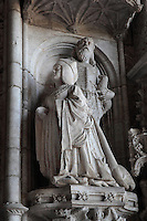 Statue of Queen Maria of Aragon kneeling, with her patron saint, John the Baptist, on the Western Portal, built 1517 in Renaissance style by Nicolau Chanterene, Church of Santa Maria, at the Jeronimos Monastery or Hieronymites Monastery, a monastery of the Order of St Jerome, built in the 16th century in Late Gothic Manueline style, Belem, Lisbon, Portugal. The monastery is listed as a UNESCO World Heritage Site. Picture by Manuel Cohen