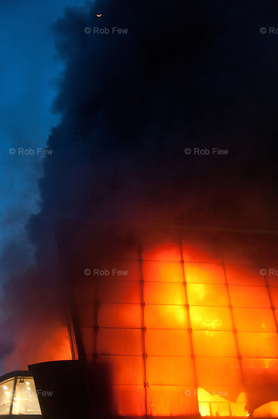 Central World burns in Ratchaprasong, one of several buildings torched by as-yet unidentified arsonists after the final clearing of the Red Shirt camp.<br /> <br /> From March to May 2010, Red Shirt protestors occupied several sites in Bangkok in an attempt to oust the government, who they believed had come to power illegitimately. <br /> <br /> When the tanks finally rolled in, clearing away the last of the Red Shirts, more than 80 people had been killed and more than 2,000 injured.