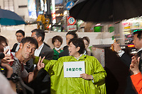 A man takes a selfie with Yuriko Koike as she is electioneering for her Party of Hope (Kibo no To) at Shibuya crossing, Shibuya, Tokyo, Japan. Friday October 13th 2017 Koike became the Governor of Tokyo after splitting from the ruling Liberal Democratic Party (LDP)  and running against their candidate. She formed her own party after Prime Minister Shinzo Abe called a snap election. Though not running for office herself this election she remains a popular figure and campaigns for her candidates. and is predicted to weaken Abe's majority. in the Diet.