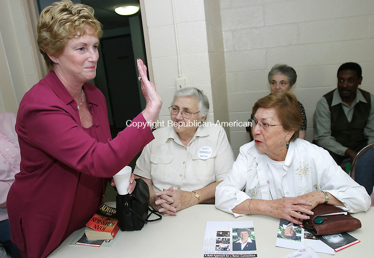 WATERBURY,  CT 04 October 2005 -100405BZ08-  Governor M. Jodi Rell, waves while talking to residents at the East Gate Apartments in support of Republican Mayoral candidate Thomas Tremaglio Tuesday afternoon.<br /> Jamison C. Bazinet / Republican-American