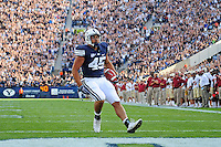 Sept. 19, 2009; Provo, UT, USA; BYU Cougars running back (45) Harvey Unga  runs into the endzone to score a second quarter touchdown against the Florida State Seminoles at LaVell Edwards Stadium. Mandatory Credit: Mark J. Rebilas-.