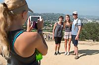 Parents Nina Srejobic and John de Benedetti pose for a photo with their daughter Natalie de Benedetti '19 in top of Fiji Hill during Orientation, Aug. 23, 2015.<br />