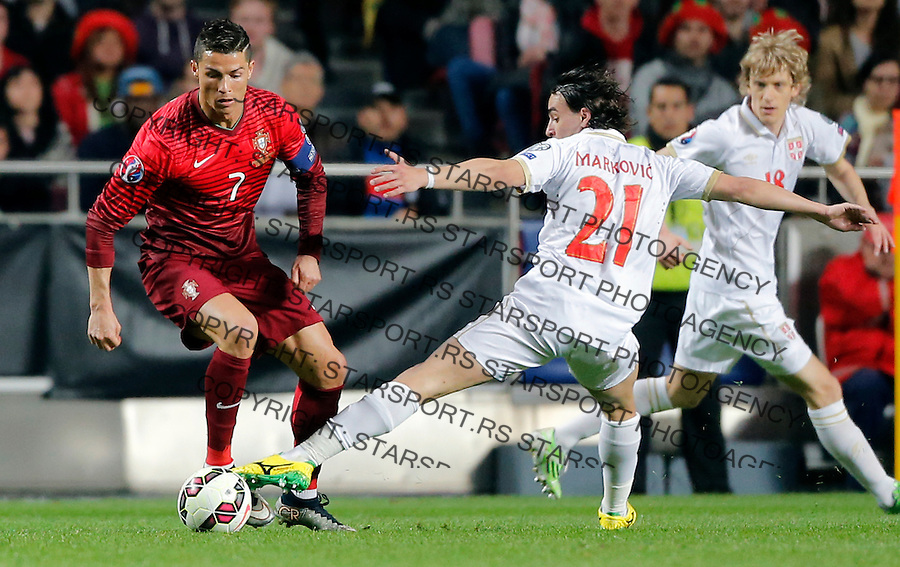 Cristiano Ronaldo Lazar Markovic Uefa EURO 2016 qualifying football match between Portugal and Serbia in Lisboa, Portugal on March 29. 2015.  (credit image & photo: Pedja Milosavljevic / STARSPORT)