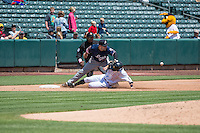 Jamie Romak (27) of the Reno Aces tries to make the tag on a sliding Gary Brown (15) of the Salt Lake Bees in Pacific Coast League action at Smith's Ballpark on May 10, 2015 in Salt Lake City, Utah.  Salt Lake defeated Reno 9-2 in Game One of the double-header. (Stephen Smith/Four Seam Images)