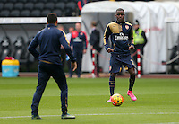 Joel Campbell of Arsenal warms up before the Barclays Premier League match between Swansea City and Arsenal played at The Liberty Stadium, Swansea on October 31st 2015