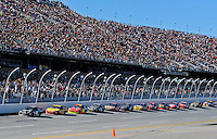Nov. 1, 2009; Talladega, AL, USA; NASCAR Sprint Cup Series driver Casey Mears leads a pack of cars single file down the front stretch during the Amp Energy 500 at the Talladega Superspeedway. Mandatory Credit: Mark J. Rebilas-