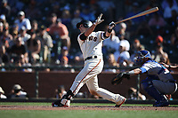 SAN FRANCISCO, CA - JULY 11:  Buster Posey #28 of the San Francisco Giants hits a game-winning double off the right field fence in the bottom of the 13th inning against the Chicago Cubs during the game at AT&T Park on Wednesday, July 11, 2018 in San Francisco, California. (Photo by Brad Mangin)