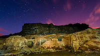 Caves at Petra Archaeological Park illuminated by flashlight at night, Jordan.