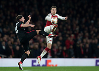 Aaron Ramsey of Arsenal and Ricardo Rodríguez of AC Milan battle for the ball during the UEFA Europa League round of 16 2nd leg match between Arsenal and AC Milan at the Emirates Stadium, London, England on 15 March 2018. Photo by Vince  Mignott / PRiME Media Images.