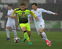 Pictured: (L-R) Josh Barrett of Reading against Adnan Maric of Swansea City Monday 15 May 2017<br /> Re: Premier League Cup Final, Swansea City FC U23 v Reading U23 at the Liberty Stadium, Wales, UK