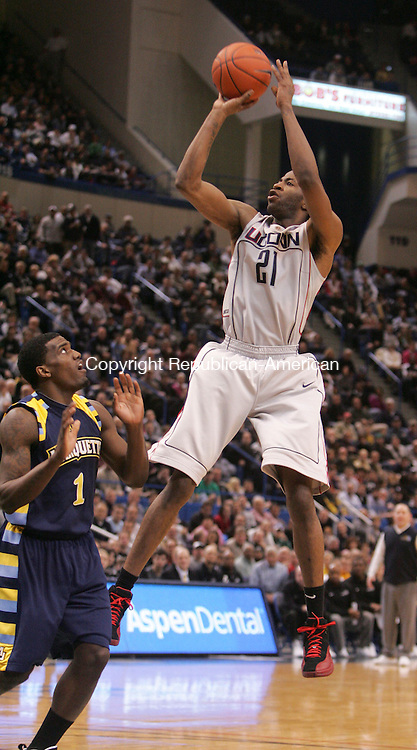 HARTFORD, CT- 30 JANUARY 2010-013010JS12--UConn's Stanley Robinson (21) puts up a shot in front of Marquette's Dariu Johnson-Odom (1) during their game Saturday at the XL Center in Hartford. <br /> Jim Shannon Republican-American