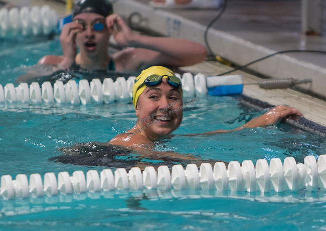 Manogue's Donna Depolo smiles after winning the girls 4A 100 yard breaststroke race during the State Swimming Meet in Carson City on Saturday, May 20, 2017.