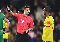 1st January 2020; Vicarage Road, Watford, Hertfordshire, England; English Premier League Football, Watford versus Wolverhampton Wanderers;  Referee Andrew Madley initially gives Christian Kabasele of Watford a yellow card but reverses this to a red after VAR review - Strictly Editorial Use Only. No use with unauthorized audio, video, data, fixture lists, club/league logos or 'live' services. Online in-match use limited to 120 images, no video emulation. No use in betting, games or single club/league/player publications