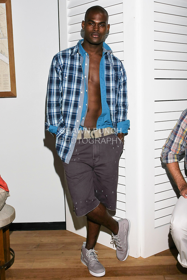 Model poses in a Nautica outfit designed by Chris Cox, at the Nautica Men's Spring 2011 Fashion presentation, during New York Fashion Week, September 10, 2010.
