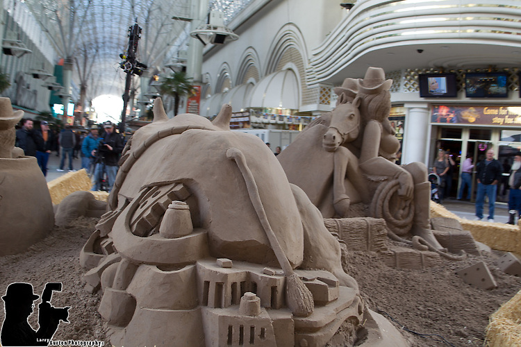 """Travel channel films """"Sand Masters"""" on Fremont Street Experience, with 50 tons of sand for a rodeo-inspired sand sculpture."""