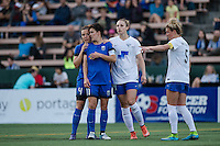 Seattle, WA - Saturday, July 02, 2016: Seattle Reign FC defender Rachel Corsie (4) and Seattle Reign FC midfielder Keelin Winters (11) during a regular season National Women's Soccer League (NWSL) match between the Seattle Reign FC and the Boston Breakers  at Memorial Stadium.