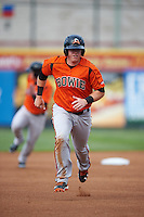 Bowie Baysox catcher Chance Sisco (12) running the bases during a game against the Erie SeaWolves on May 12, 2016 at Jerry Uht Park in Erie, Pennsylvania.  Bowie defeated Erie 6-5.  (Mike Janes/Four Seam Images)