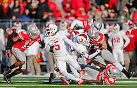 Ohio State Buckeyes defensive back Vonn Bell (11) takes down Indiana Hoosiers cornerback Noel Padmore (5) on a kick return in the fourth quarter of the college football game between the Ohio State Buckeyes and the Indiana Hoosiers at Ohio Stadium in Columbus, Saturday afternoon, November 22, 2014. The Ohio State Buckeyes defeated the Indiana Hoosiers 42 - 27. (The Columbus Dispatch / Eamon Queeney)