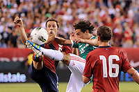 Steve Cherundolo (6) of the United States and Andres Guardado (18) of Mexico go for the ball. The men's national teams of the United States (USA) Mexico (MEX) played to a 1-1 tie during an international friendly at Lincoln Financial Field in Philadelphia, PA, on August 10, 2011.