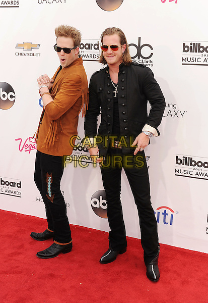 LAS VEGAS, CA- MAY 18: Brian Kelley; Tyler Hubbard arrives at the 2014 Billboard Music Awards at the MGM Grand Garden Arena on May 18, 2014 in Las Vegas, Nevada.<br /> CAP/ROT/TM<br /> &copy;TM/Roth Stock/Capital Pictures