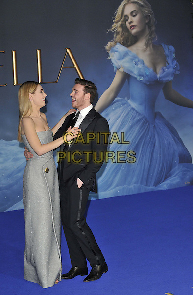 LONDON, ENGLAND - MARCH 19: Lily James &amp; Richard Madden attend the &quot;Cinderella&quot; UK film premiere, Odeon Leicester Square cinema, Leicester Square, on Thursday March 19, 2015 in London, England, UK. <br /> CAP/CAN<br /> &copy;Can Nguyen/Capital Pictures