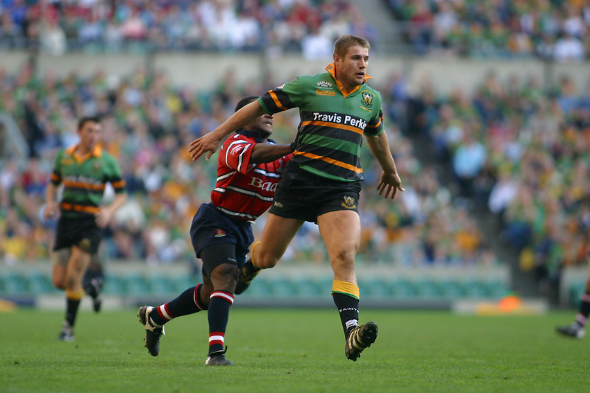 Photo. Jo Caird.Gloucester v Northampton Saints. Powergen Cup Final. 05/04/2003.Ben Cohen is pushed by Marcel Garvey