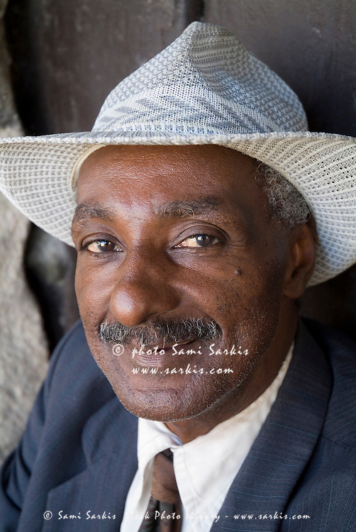 Portrait of a man wearing a vintage suit and fedora, Havana, Cuba.