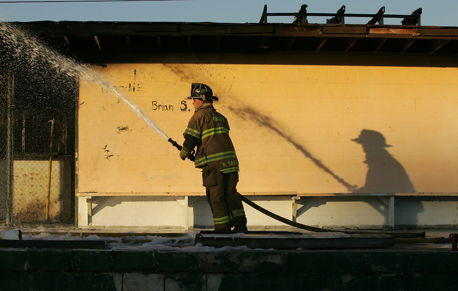 A firefighter is reflected by the setting sun. Photo/Andrew Shurtleff