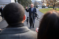 US President Donald J. Trump delivers remarks as he walks to board Marine One on the South Lawn of the White House  in Washington DC, USA, 02 December 2017. President Trump commented on the tax reform package passed by the Senate and on the guilty plea by former National Security Advisor Michael Flynn.<br /> Credit: Shawn Thew / Pool via CNP