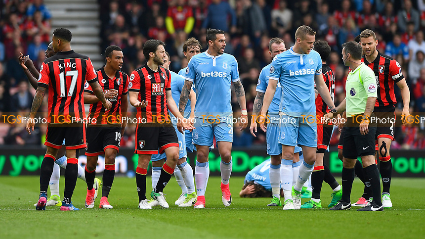 Stoke City skipper Ryan Shawcross of Stoke City has words with Referee Paul Tierney regarding a tackle on Joe Allen of Stoke City (on ground)  by Harry Arter of AFC Bournemouthduring AFC Bournemouth vs Stoke City, Premier League Football at the Vitality Stadium on 6th May 2017