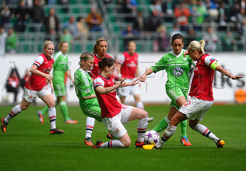 21.04.2013. Wolfsburg, Germany. Womens Champions League, Wolfsburg versus Arsenal, second leg.  l-r: Conny POHLERS (VfL Wolfsburg), Niamh FAHEY (FC Arsenal London) , Nadine KESSLER (VfL Wolfsburg), Steph HOUGTON (FC Arsenal London)