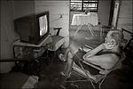 Cojimar, Cuba:<br /> Cojimar, man watching tv