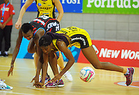 Ama Agbeze intercepts a pass to Mwai Kumwenda during the ANZ Netball Championship match between the Central Pulse and Mainland Tactix at Te Rauparaha Arena, Wellington, New Zealand on Saturday, 11 May 2015. Photo: Dave Lintott / lintottphoto.co.nz