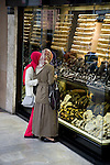 Muslim women window shopping for jewelry in Istanbul, Turkey