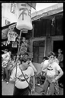 Hong Kong believers take part in a religious procession during the Bun Festival on Cheung Chau Island, Hong Kong, 1983.