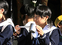 A young woman drinks water from Otowa-no-taki waterfall at Kiyomizu-dera temple in Kyoto, Japan, on November 7, 2006. Otowa-no-taki is a waterfall where visitors drink for health, longevity, and success in studies. Kiyomizu-dera (or Otowa-san Kiyomizu-dera) is an independent Buddhist temple in eastern Kyoto. Kyoto is the former imperial capital of Japan, and today houses more than 1.5 million. Photo by Lucas Schifres/Pictobank