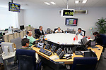 March 18, 2011, Tokyo, Japan - Japanese money traders go about their business in Tokyo on Friday, March 18, 2011. The yen nose-dived as low as 81.51 yen after Group of Seven finance ministers agreed to joint intervention to weaken the yen. (Photo by Yusuke Nakanishi/AFLO) [1090] -mis-