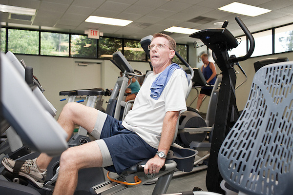 July 29, 2011. Cary, NC.. Jamie Mason, a 15 year veteran of SAS, works out in the free on campus gym.. Profile of SAS, a software company that has many amenities for its employees.