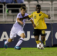 Marc Pelosi (11) of the United States fights for the ball with Jason Wright (10) of Jamaica during the semifinals of the CONCACAF Men's Under 17 Championship at Catherine Hall Stadium in Montego Bay, Jamaica. The United States defeated Jamaica, 2-0.