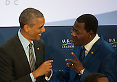 United States President Barack Obama chats with Benin President Boni Yayi before participating in ìLeaders Session Three: Governing the Next Generation,î during the Africa Leaders Summit at the State Department in Washington, DC, August 6, 2014.  Obama is promoting business relationships between the United States and African countries during the three-day U.S.-Africa Leaders Summit, where 49 heads of state are meeting in Washington.  <br /> Credit: Molly Riley / Pool via CNP