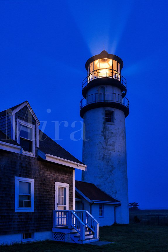 Ligthouse casts guiding light into dark blue night, Truro, Cape Cod, Massachusetts, USA